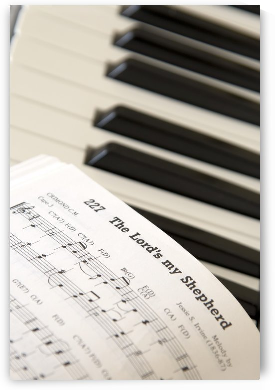 Close Up Of Sheet Music On Piano Keyboard by PacificStock