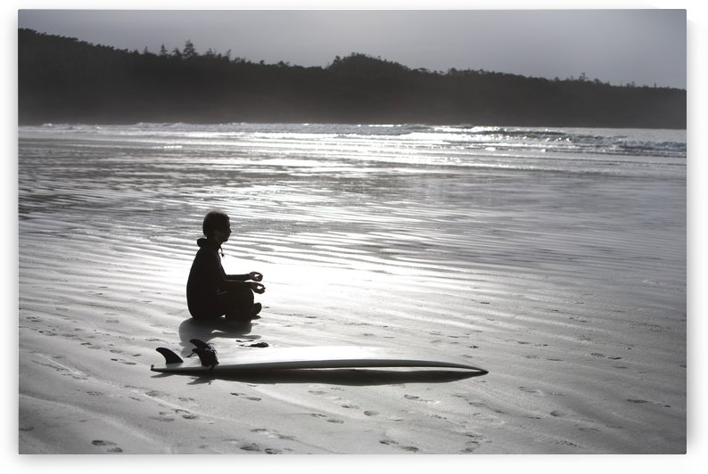 Surfer Meditating On Beach, Cox Bay Near Tofino, British Columbia, Canada by PacificStock