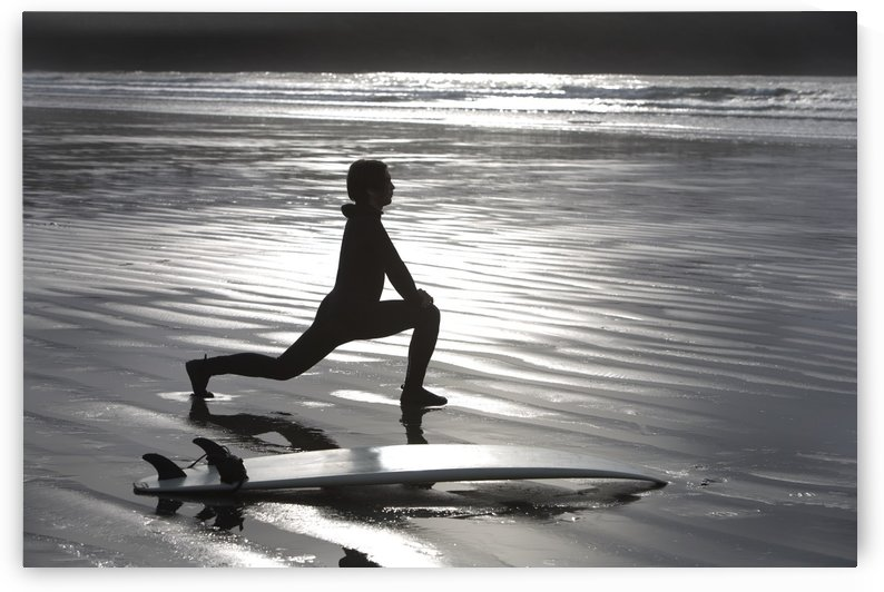 Surfer Stretching On Beach by PacificStock