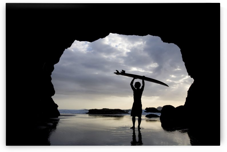 Surfer Inside A Cave At Muriwai North Island New Zealand by PacificStock