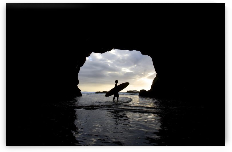 Surfer Inside A Cave At Muriwai New Zealand by PacificStock