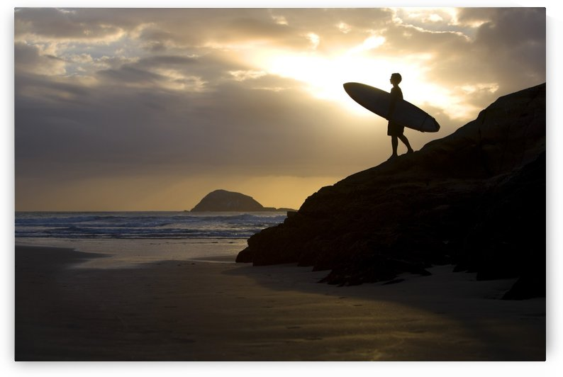 A Surfer On Muriwai Beach New Zealand by PacificStock