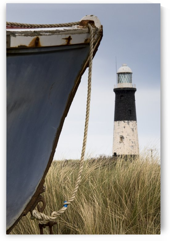 Abandoned Boat And Lighthouse, Humberside, England by PacificStock