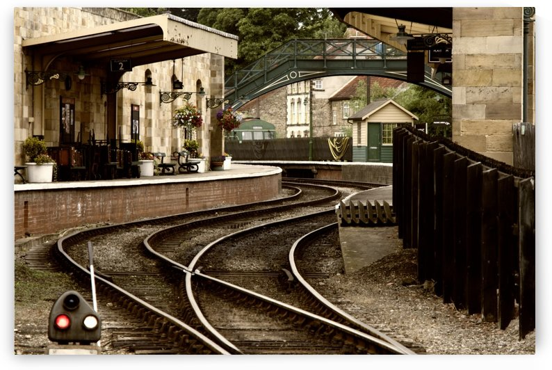An Old-Fashioned Train Station And Tracks by PacificStock