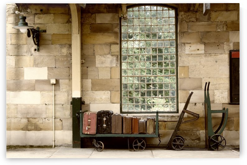Suitcases On A Luggage Trolley In A Train Station by PacificStock