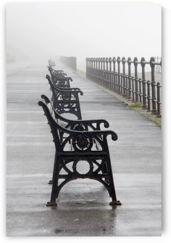 Redcar, North Yorkshire, England; Row Of Benches Overlooking The Beach And Sea by PacificStock