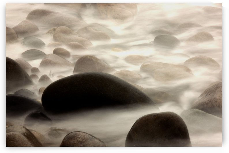 Fog Rolling Over Rocks by PacificStock
