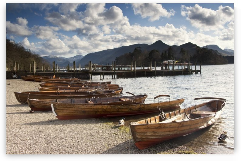 Lake District, Cumbria, England; Rowboats On Shore by PacificStock