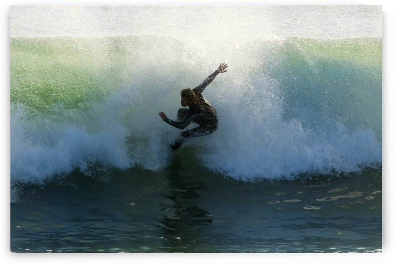 Surfer Catching A Wave by PacificStock