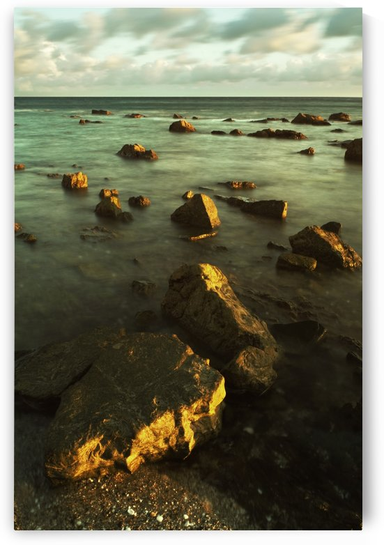 Rocks In Shallow Water By The Shore by PacificStock