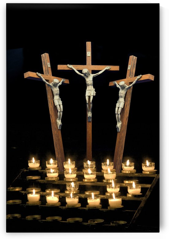 Three Crosses Depicting Crucifix With Candles by PacificStock