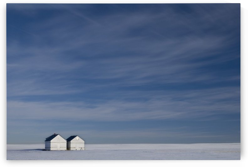 Hussar, Alberta, Canada; Two Small Farm Buildings In Flat Winter Landscape by PacificStock