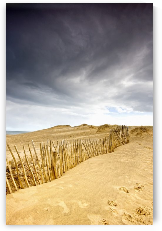South Shields, Tyne And Wear, England; Dark Skies Over Beach With Fence by PacificStock