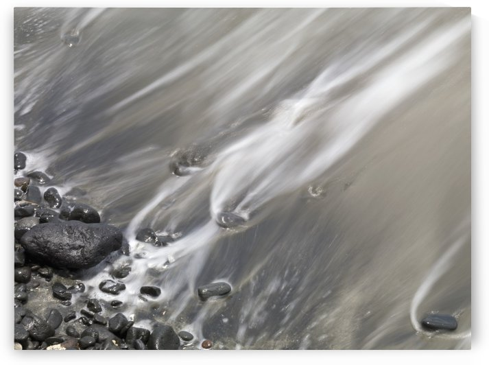 Shoreline; Water Lapping Up Against A Rocky Shoreline by PacificStock