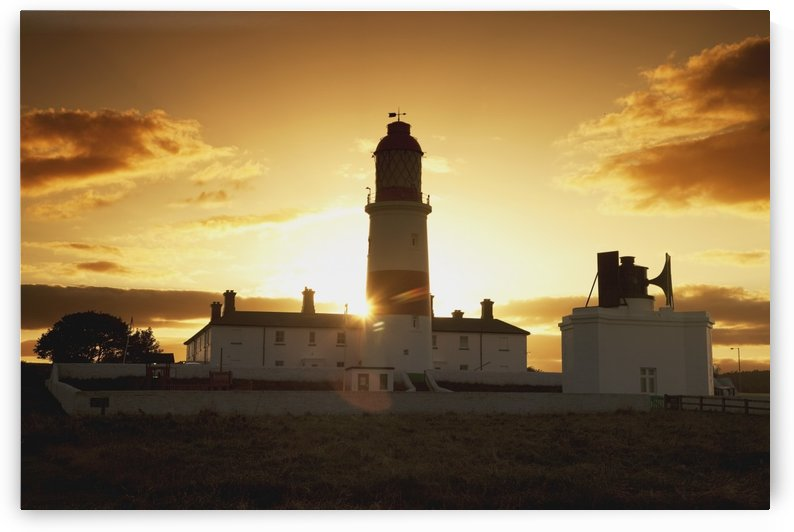 Sunset Behind Lighthouse by PacificStock
