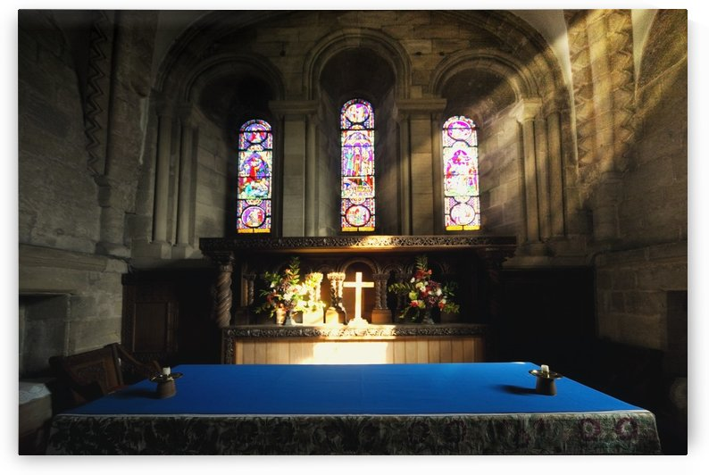 Cross Illuminated At The Altar Of A Church by PacificStock