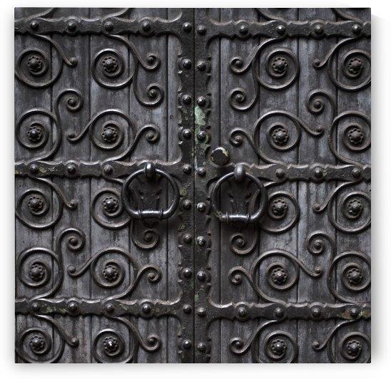 Door Handles On Ornate Metal Doors by PacificStock