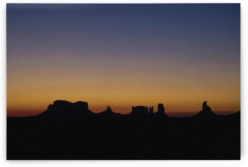 Silhouette Of Rock Formations At Sunset by PacificStock