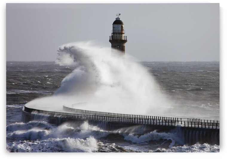 Sunderland, Tyne And Wear, England; Waves Crashing Into A Pier And Lighthouse by PacificStock