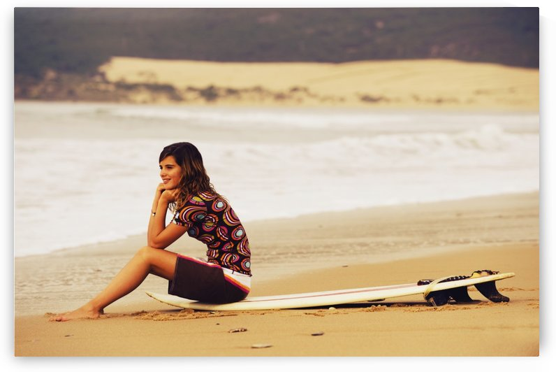Young Woman Sitting On Her Surf Board On The Beach; Tarifa, Cadiz, Andalusia, Spain by PacificStock