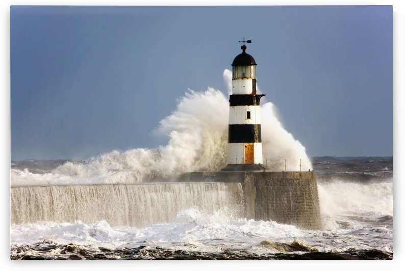 Seaham, Teesside, England; Waves Crashing Against A Lighthouse by PacificStock