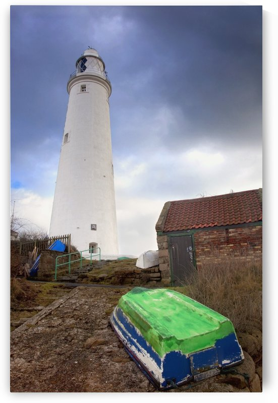Whitley Bay, Northumberland, England; A Boat On The Shore And St. Mary's Lighthouse by PacificStock
