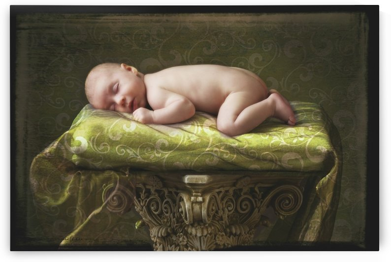 A Baby Asleep On A Pillar by PacificStock