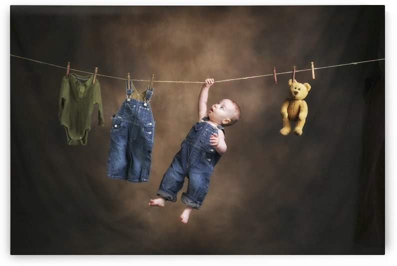 A Baby On The Clothesline by PacificStock