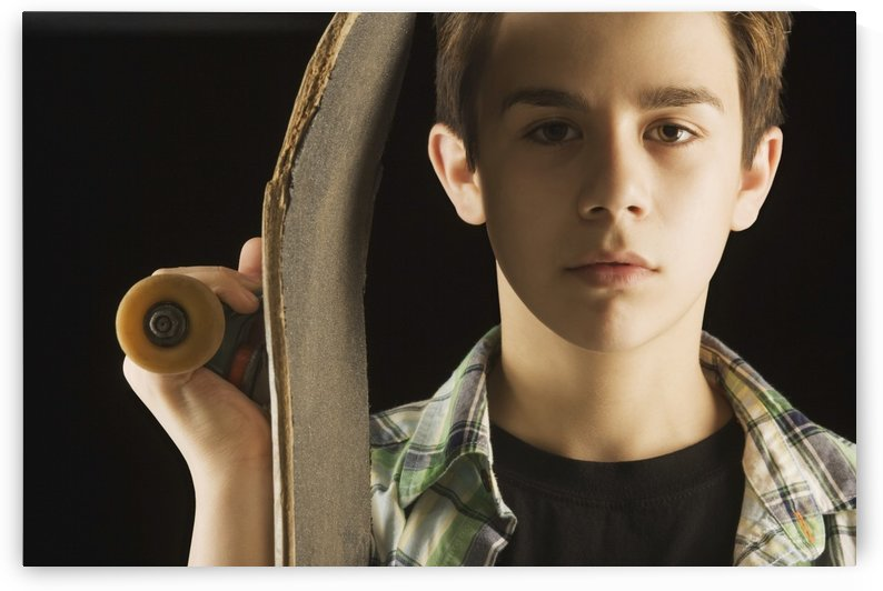 A Boy With A Skateboard by PacificStock