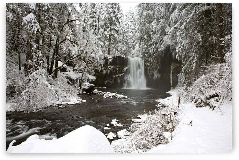 A Waterfall In To A River In Winter by PacificStock