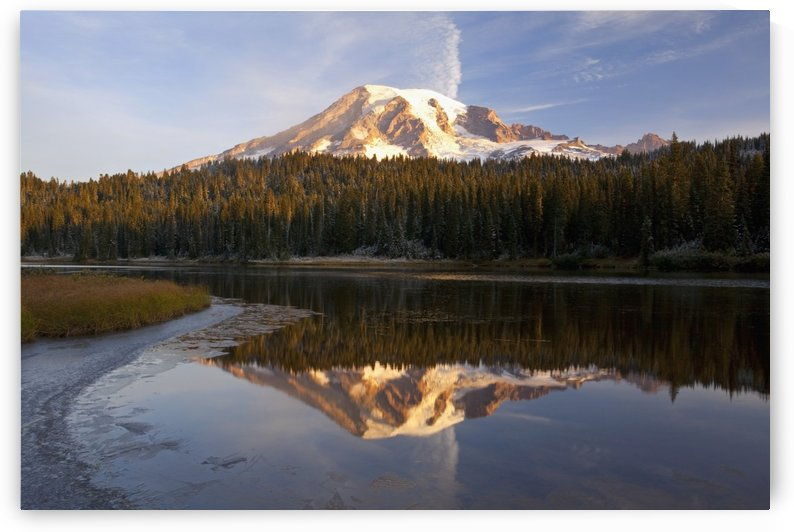 Washington, United States Of America; Reflection Of Mount Rainier In A Lake With Ice On The Surface In Mt. Rainier National Park by PacificStock
