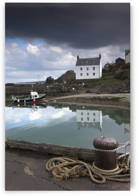 Houses Along The Water And A Boat On The Shore; St. Abb's Head, Scottish Borders, Scotland by PacificStock