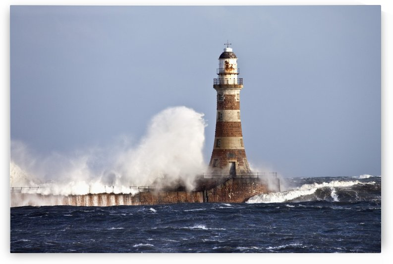 Waves Crashing Against Roker Lighthouse; Sunderland, Tyne And Wear, England by PacificStock