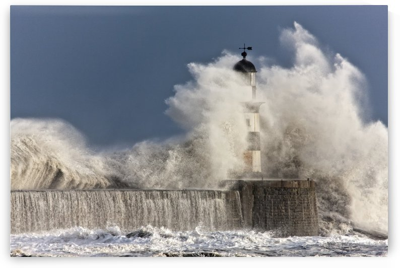 Waves Crashing Up Against A Lighthouse; Seaham, Teesside, England by PacificStock