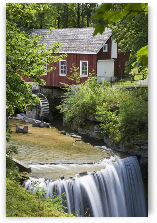 Red Barn With A Mill Wheel And Waterfall; Thorold, Ontario, Canada by PacificStock