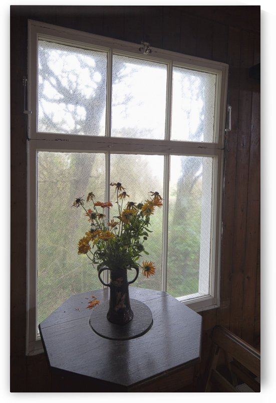 A Bouquet Of Flowers In A Vase On A Table By The Window; Northumberland, England by PacificStock