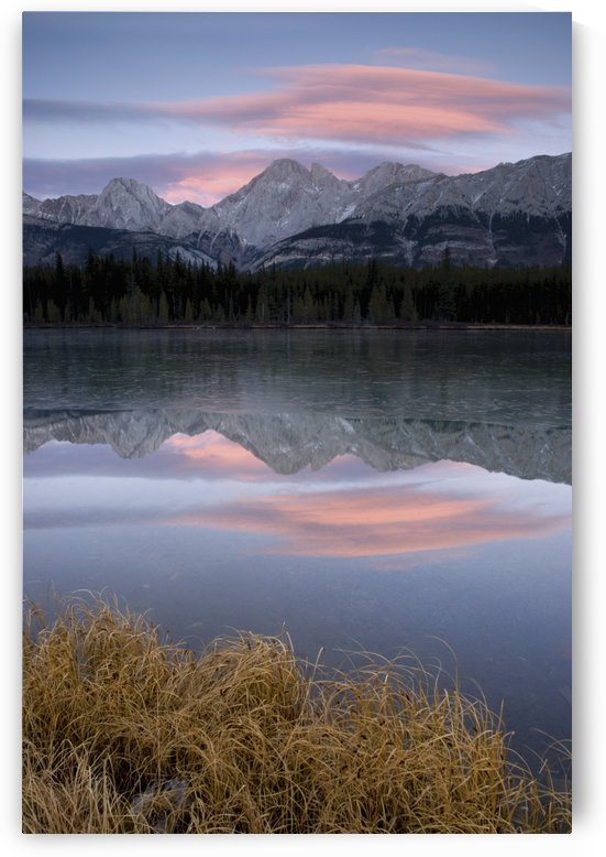 Partially Frozen Spillway Lake At Sunset; Kananaskis, Alberta, Canada by PacificStock