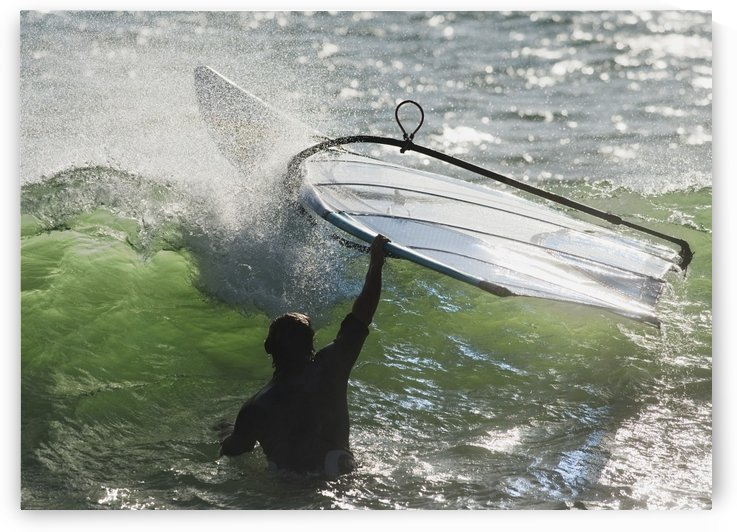 A Man In The Water Holding Onto His Windsurfing Board; Tarifa, Cadiz, Andalusia, Spain by PacificStock