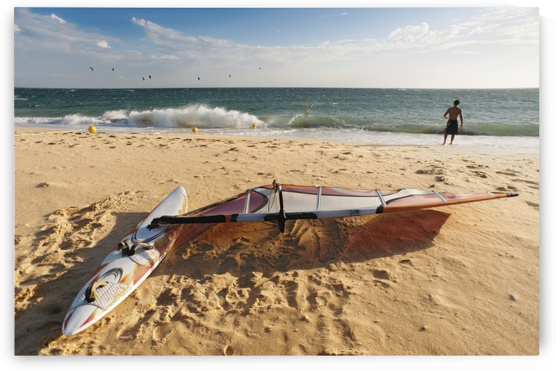 A Man On The Beach With His Windsurfing Board; Tarifa, Cadiz, Andalusia, Spain by PacificStock