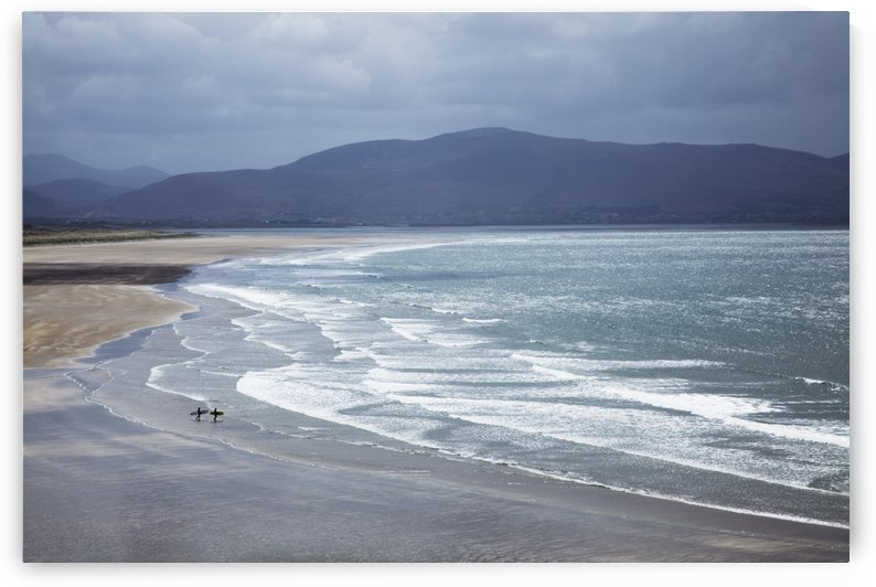 Two People Walking With Surfboards On The Beach In Inch On The Dingle Peninsula; County Kerry, Ireland by PacificStock