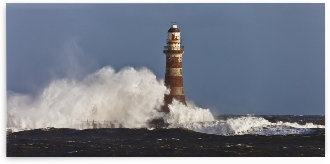 Waves Crashing Against A Lighthouse; Sunderland, Tyne And Wear, England by PacificStock