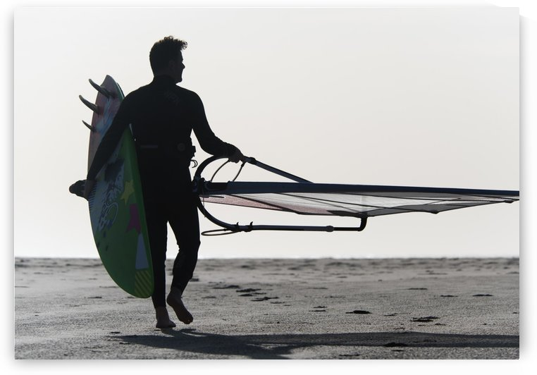 A Man Walking On The Beach Carrying A Kite Surfboard; Tarifa, Cadiz, Andalusia, Spain by PacificStock