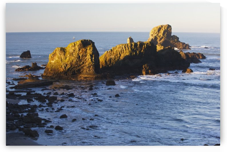 Sun Shining On The Rocks At Sunrise At Ecola State Park; Oregon, United States Of America by PacificStock