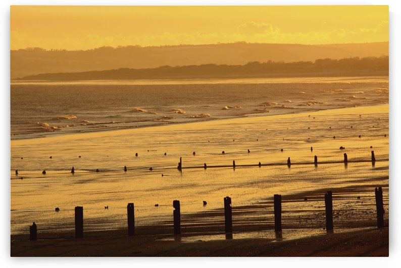 Sunset Over Beach In Winter; Youghal Beach, East Cork, Ireland by PacificStock