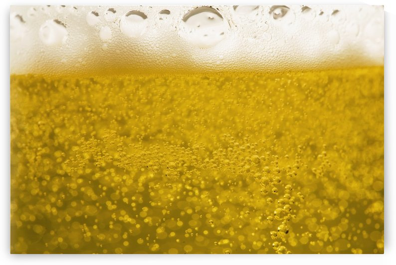 Close-Up Of Beer Bubbles And Foam In A Glass by PacificStock