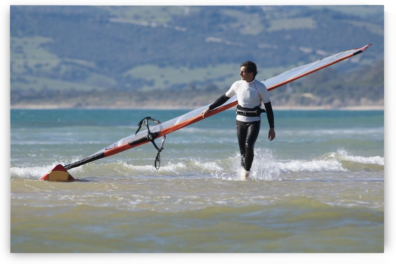 Windsurfer Carrying Surfboard; Los Lances Beach Tarifa Spain by PacificStock