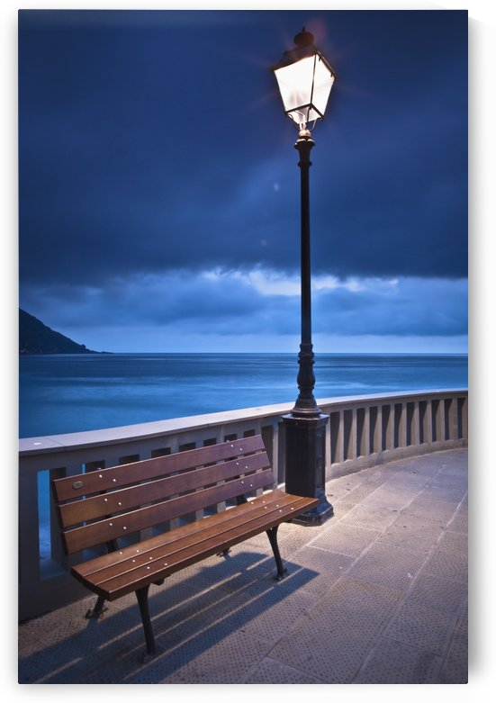 A Bench And Light Post Along The Railing On The Coast; Camogli, Liguria, Italy by PacificStock