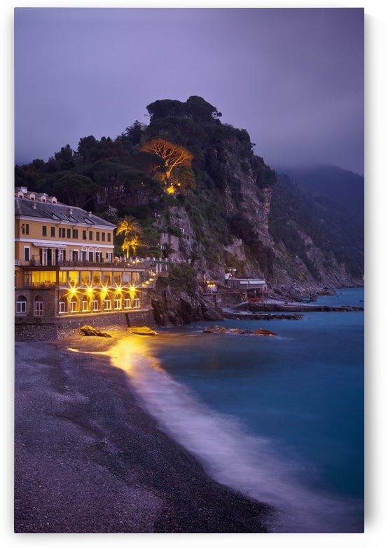 A Building Illuminated At Night Along The Coast; Camogli, Liguria, Italy by PacificStock