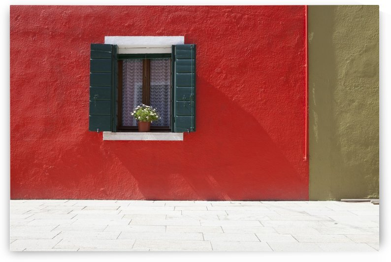 A Flower Pot Sits In A Window With Shutters Open In Building Painted Bright Red; Burano, Venezia, Italy by PacificStock