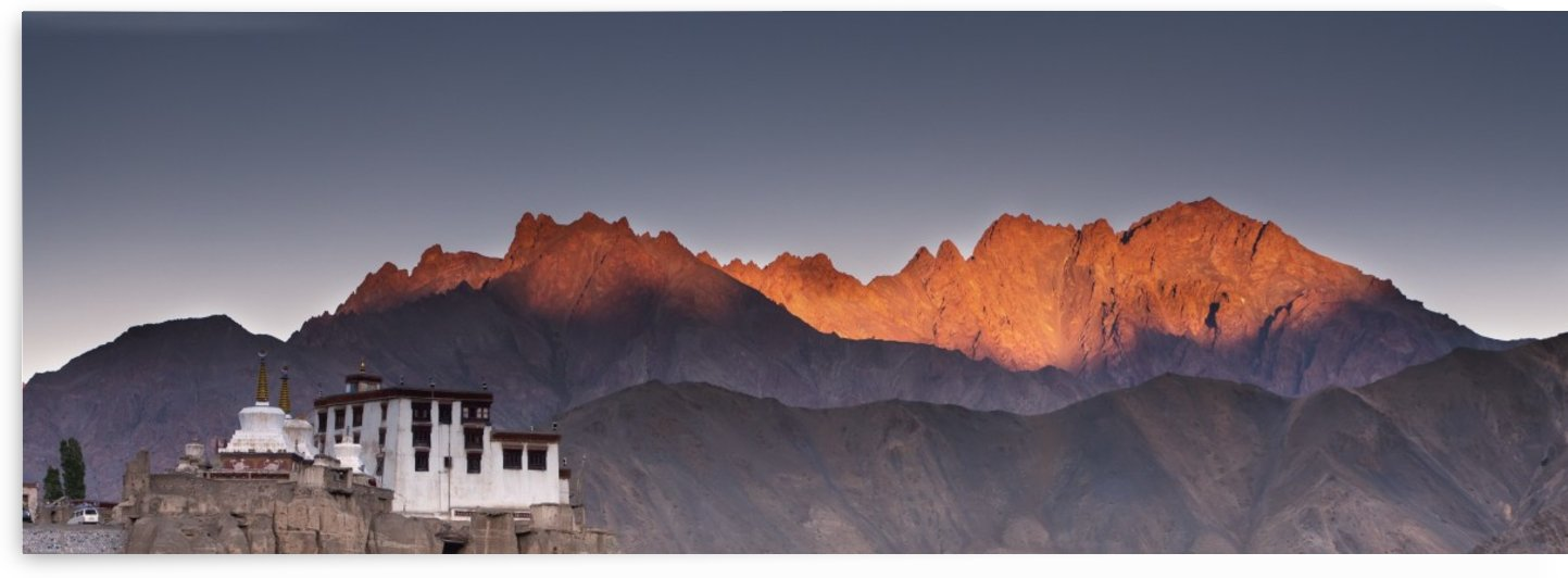 A Building On A Rock Ledge With Alpenglow Over The Mountains In The Background; Lamayuru, Ladakh, India by PacificStock